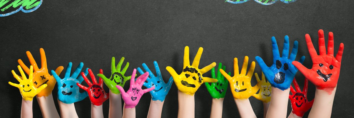 Colorful,Hands,In,Front,Of,A,Chalkboard,With,Clouds